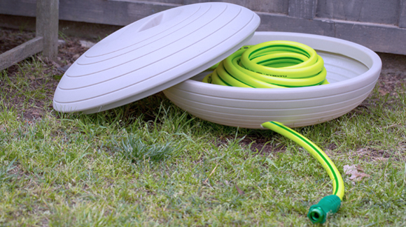 Crescent Garden Mia hose storage container with a Flexzilla ZillaGreen garden hose